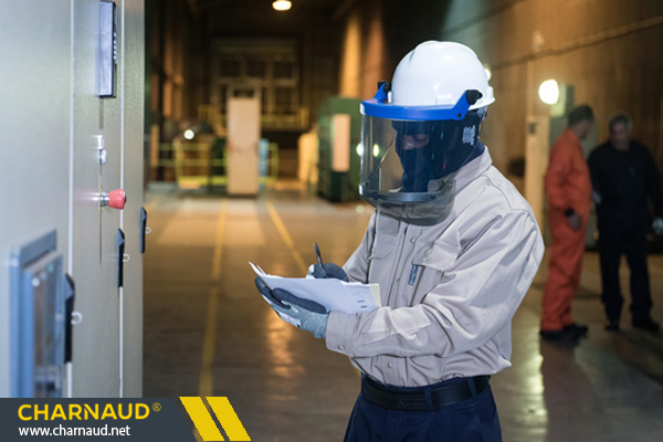 a man with a clipboard wearing protective gear conducting an inspection